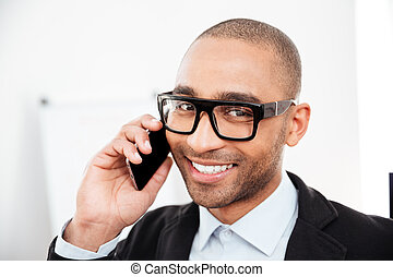 Close-up portrait of businessman talking on the mobile phone