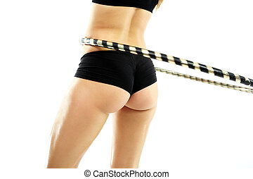 hula hoops - The woman is training your abdominal muscles by...