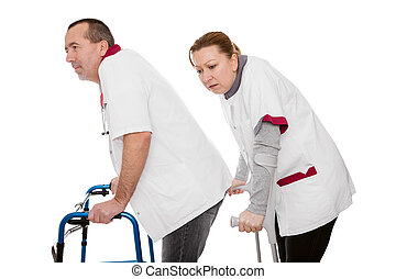 two revised nurses are limping, isolated on white