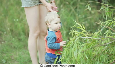 Baby on picnic nature - Nature baby boy on blanket looking...