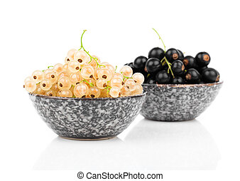 White currant fruit in a bowl, isolated over white...