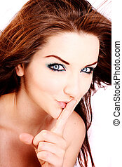 Shhh! - A close up of a beautiful woman telling you to keep...