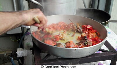 preparation of Lobster with tomatoes in a pan for Italian...