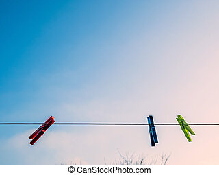 colorful clothespins on clothesline - colorful clothespins...
