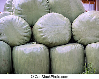 bales of fodder for winter - a farmer has stacked bales of...