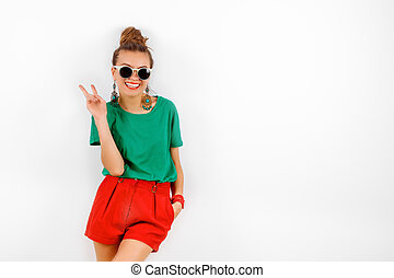 beautiful woman in sunglasses wearing in red shorts and...