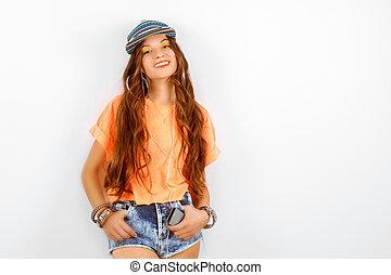 beautiful woman wearing blue cap in orange T-shirt standing...