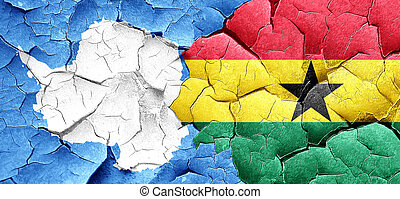 antarctica flag with Ghana flag on a grunge cracked wall