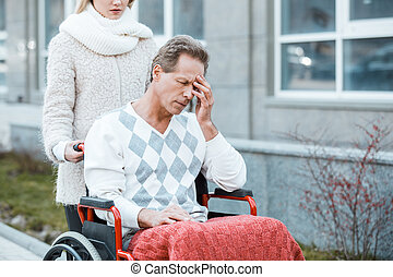 Concept for man on wheelchair - Adult man in wheelchair...