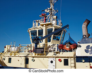 Supply utility ship vessel with clear blue sky background