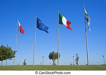 Flags on blue sky.