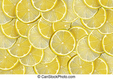 Yellow background with citrus-fruit of lemon slices