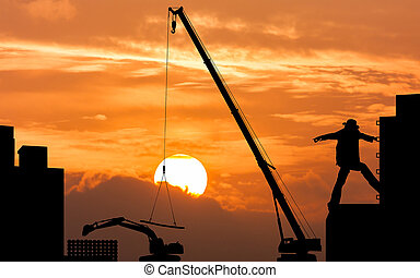 silhouette of  foreman worker controlling the excavator