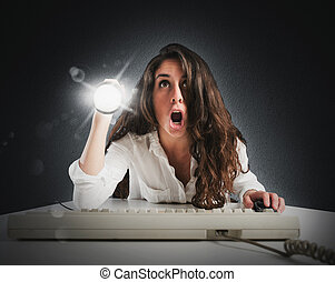 Web discoveries - Amazed woman with torch and computer...