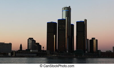 Timelapse of the Detroit skyline from day to night across...