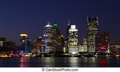 Timelapse of the Detroit skyline at night across river - A...