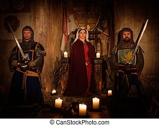 Medieval queen with her knights on guard in ancient castle...