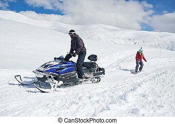 snowmobile drags girl snowboarder - snowmobile drags in tow...