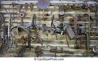 Old rusty farm tools and parts - Rusty old farm tools and...