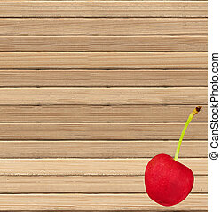 Red cherry on a wooden background