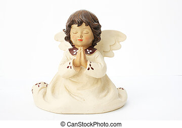 angel - a ceramic angel praying isolated on white