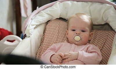 Cute little baby with pacifier. - Newborn baby lying in a...