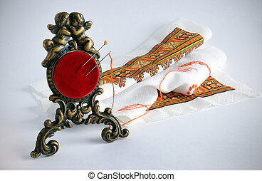 Antique pincushion and embroidery - An antique red...