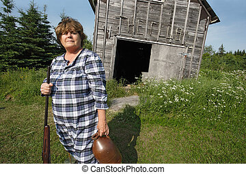 Redneck woman with gun - Moonshine Mary stands proud...