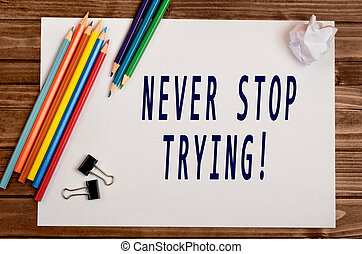 The words Never stop trying on paper - The words Never stop...