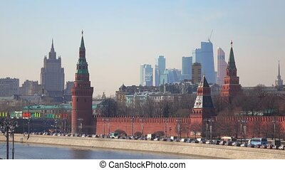 Traffic on Moscow Kremlin embankment and distant business center 'Moscow city'