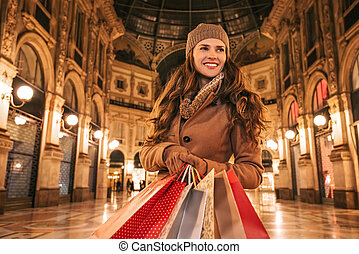 Woman with shopping bags in Galleria Vittorio Emanuele II -...