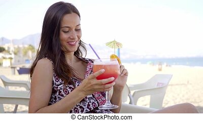 Happy friendly woman drinking a tropical cocktail - Happy...