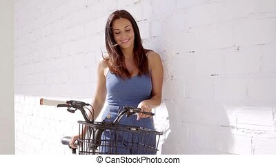 Pretty smiling woman with a bicycle - Pretty smiling woman...