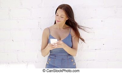 Pretty young woman checking a text message - Pretty young...