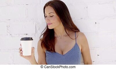 Pretty young woman drinking takeaway coffee - Pretty young...