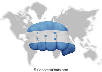 fist with the national flag of honduras on a world map...