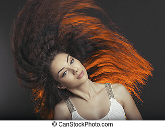 Hair toss - Beautiful young lady tossing sideways her rich...