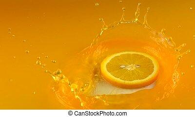 Orange slice hits orange juice surface. Slow motion shot...