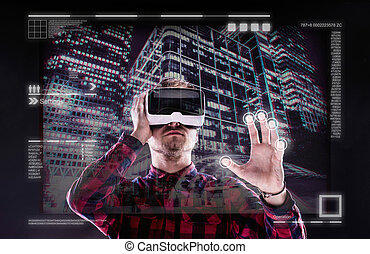 Man wearing virtual reality goggles Studio shot, black...