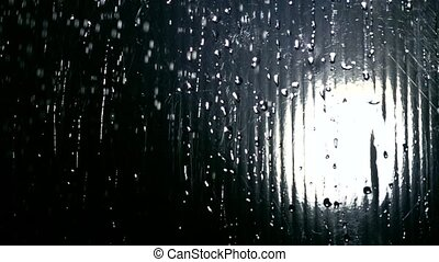 Turning on water in the shower super slow motion shot