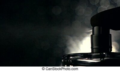 Man spraying fragrance against dark bokeh background super...