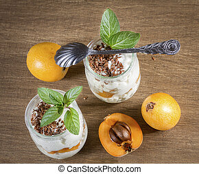 Fresh Yogurt with Loquats and Flaxseed on Rustic Background....
