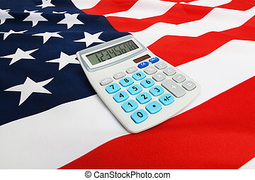 Ruffled national flag with calculator over it - United...