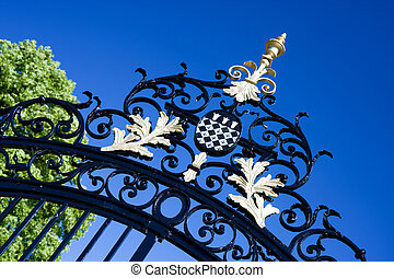 The crest of Magdalen College, Oxford on an iron gate