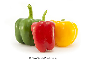 Red, Green and Yellow peppers isolated on white