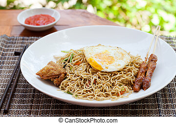 Nasi Goreng with fried egg, chicken Indonesian stir fried...