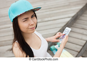 Girl using big modern phablet smartphone with big screen -...
