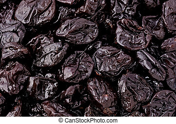 Prunes - Background texture of several prunes.