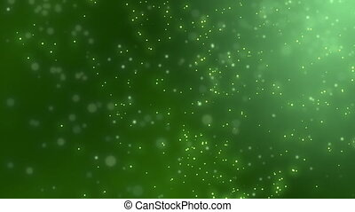Abstract sharp and blurred particles swarming against green...