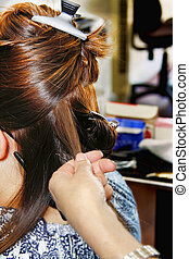 At the hairstylist - Female at the hairstylist getting a...